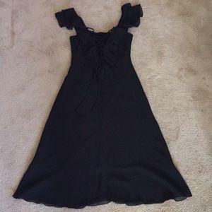 Black ruffle dress.